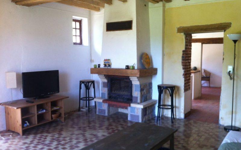 longère salon cheminée